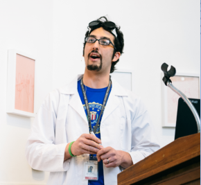 Image of Kevin Impellizeri, Youth Program Coordinator at the College of Physicians of Philadelphia, dressed in a lab coat and goggles.
