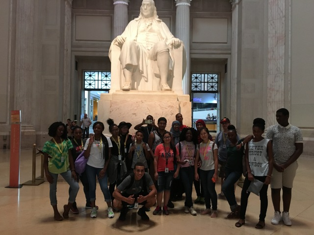 The Karabots Junior Fellows pose in front of the statue of Benjamin Franklin at the Franklin Institute