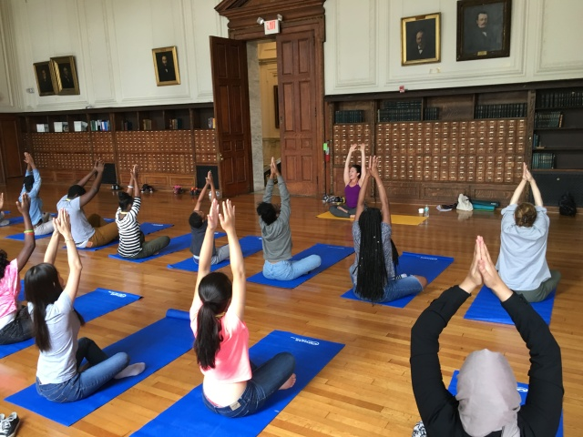 The Karabots Junior Fellows take part in a yoga demonstration led by Laura Baehr
