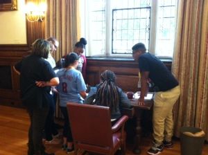 "Karabots Fellows solving puzzles in the Room Escape Game ""Dr. Mutter's Secret Specimen"""