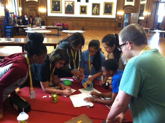 "Karabots Fellows solving puzzles in the Room Escape Game ""Dr. Mutter's Secret Specimen"""