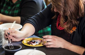 A visitor designing a sugar skull at the Mutter Museum Day of the Dead event, 10/31/15