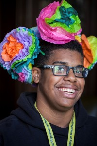 KJF4 Fellow Victor showing off his homemade paper flowers at at the Mutter Museum Day of the Dead event, 10/31/15
