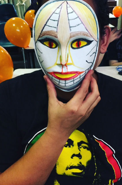 One Out4STEM student shows off a mask made at the annual Out4STEM Masquerade event, 10/29/15
