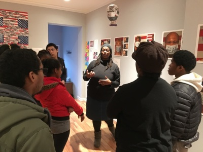Teva Interns meet with Tieshka Smith to discuss her installation: Racism is a Sickness