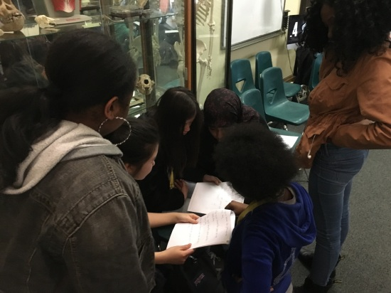 Students in the Karabots Junior Fellows Program examine a questioned document during a lesson on handwriting analysis