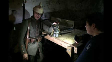 A Teva fellow learns about the life of a World War I soldier from a German re-enactor at Fort Mifflin
