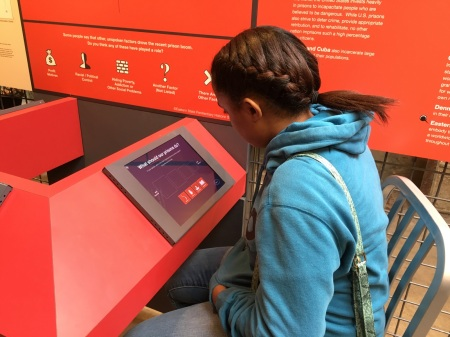 One of the Teva fellows interacts with a touch screen-based poll at Prison's Today, an exhibit on mass incarceration at Eastern State Penitentiary
