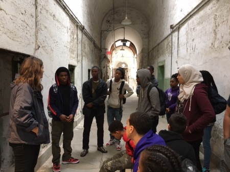 Students from  the Karabots Junior Fellows Program and the Teva Pharmaceuticals Internship Program discuss prisons wih Eastern State Penitentiary Tour Guide Lauren Bennett