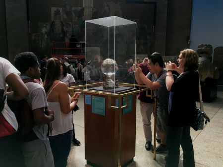 Students from the Teva Internship Program observe artifacts at the Penn Museum