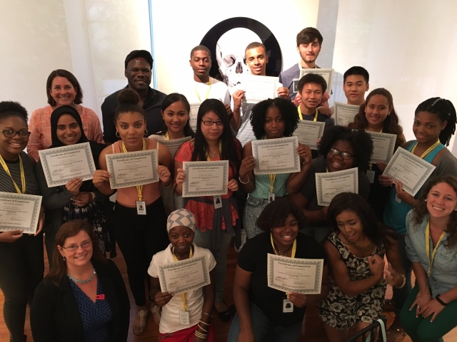 The 2016 cohort of the Teva Pharmaceuticals Internship program pose with Teva employees and hold certificates of completion for completing their summer internship
