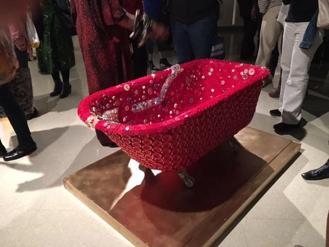 A piece depicting a bathtub covered in buttons in the African American Museum in Philadelphia exhibit I Found God in Myself