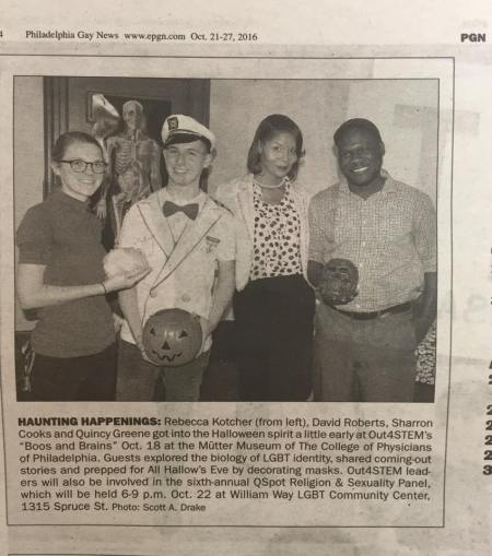 Clipping from Philadelphia Gay News displaying four participants holding skulls and jack-o-lanterns at the Out4STEM event Boos and Brains.