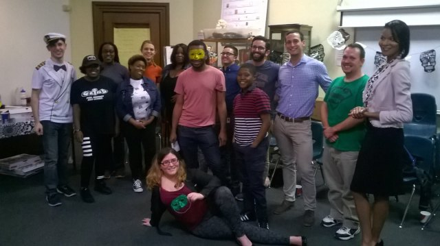 """Participants of the """"boos and Brains"""" event hosted by the Out4STEM Program pose with homemade masks"""
