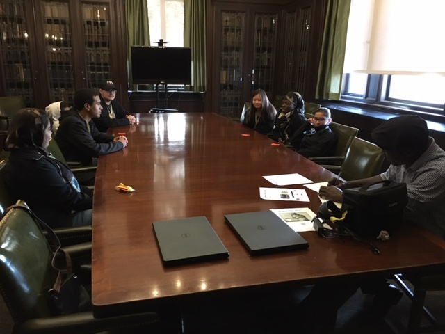 Students sit around a long table in the Gross conference room to develop a platform for their political party as part of the Project Voice 2016 event