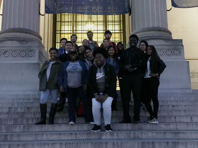 Students in the Teva Pharmaceuticals Internship Program pose on the marble steps in front of the Franklin Institute