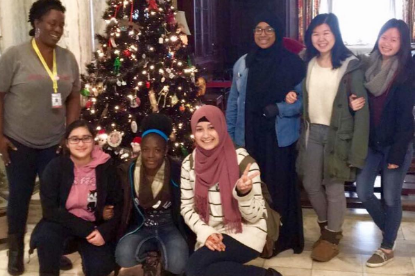 STudents in the Karabots Junior Fellows Program pose in front of the Mütter Museum Christmas tree