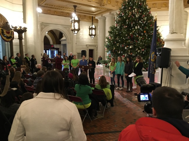 Teva intern Su Ly stands at a podium in front of attendees to the proclamation of Pennsylvania Teen Health Week 2017 at the Pennsylvania State House
