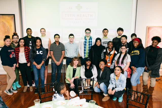 Philadelphia teens pose for a group photo with Dr. Laura Offutt at the Teen Health Week Party Photo: Hieu Pham