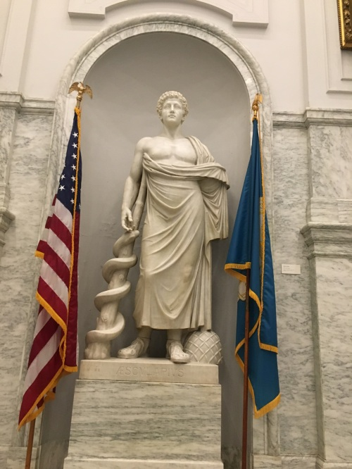 Marble statue of Aesculapius at the top of the main staircase at the College of Physicians of Philadelphia