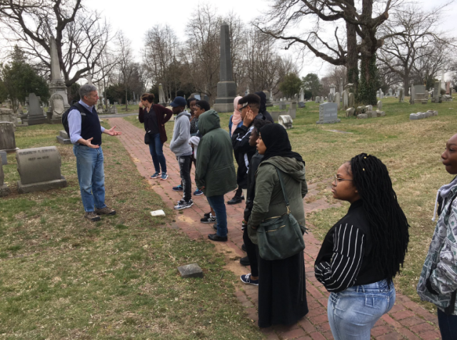 Jim Mundy delivers a tour for youth from the Karabots Junior Fellows Program at the Woodlands Cemetery
