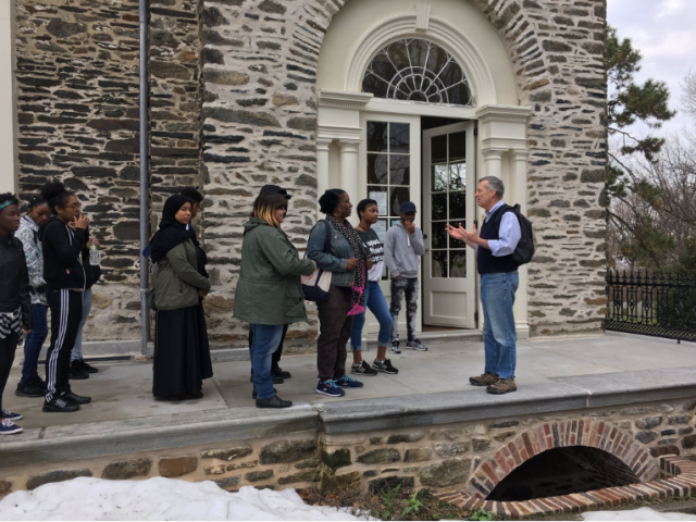 Jim Mundy delivers a tour for the Karabots Junior Fellows outside the William Hamilton mansion at the Woodlands Cemetery
