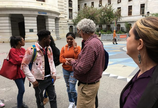 Students in the Karabots Junior Fellows Program talk with Michael Nairn, Professor of Urban Planning at Penn, in the courtyard of Philadelphia City Hall
