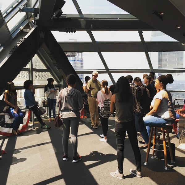 Students in the Teva Pharmaceuticals Internship Program hear a lecture from Penn Urban Studies professor Michael Nairn at the Liberty Place Observation Deck