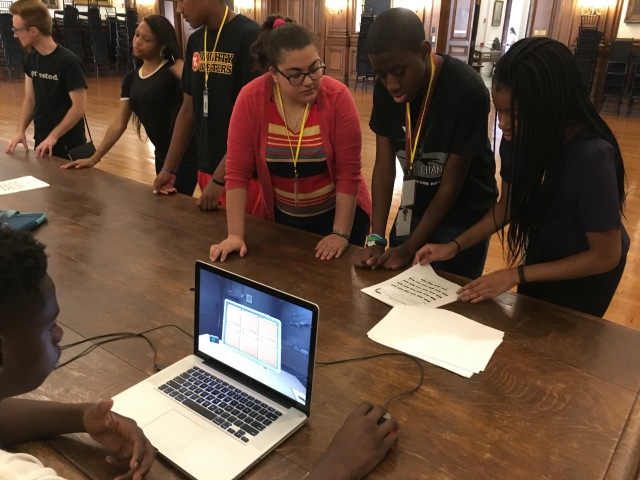 "Students in the Karabots Junior Fellows Program play the cooperative computer game ""Keep Talking and Nobody Explodes"""