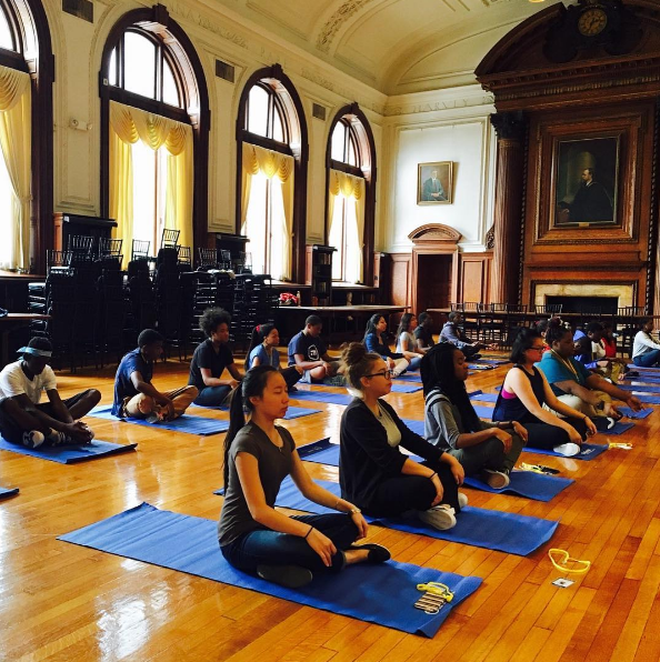 Students in the Karabots Junior Fellows Program take part in a yoga session.