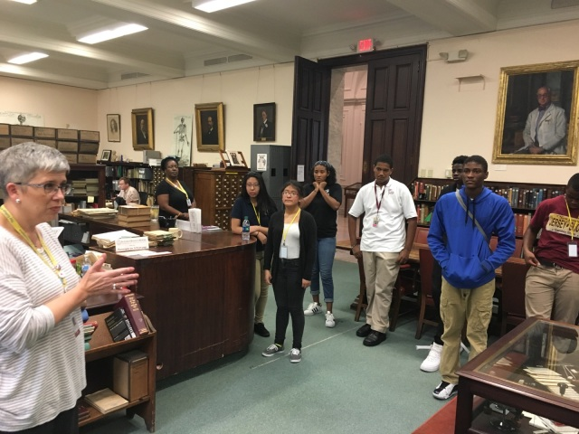 Students in the Karabots Junior Fellows Program meet with College Librarian Beth Lander during a tour of the Historical Medical Library