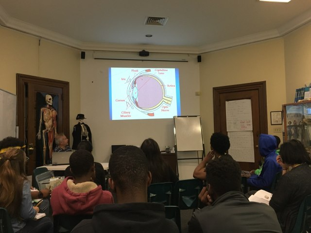 Dr. Michael DellaVecchia delivers a presentation on ophthalmology to students in the Karabots Junior Fellows Program