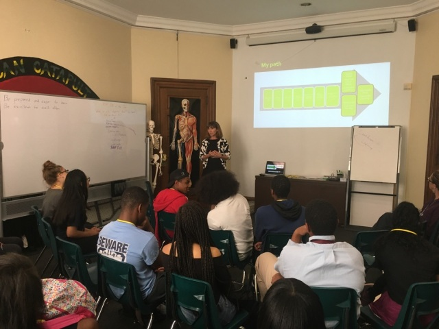 Students in the Karabots Junior Fellows Program observe a slide presented by Dr. Laura Offutt as part of a lesson on teen health