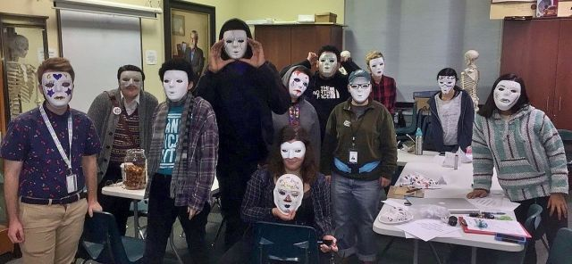 Students in the Out4STEM Internship Program pose wearing homemade masks