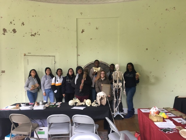 A group photo of students in the Karabots Junior Fellows Program in the Hamilton mansion at the Woodlands Cemetery