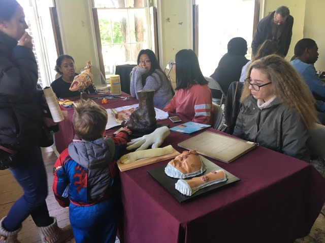 Students in the Karabots Junior Fellows Program demonstrate specimens to attendees of the Halloween Family Fun Day event at the Woodlands Cemetery
