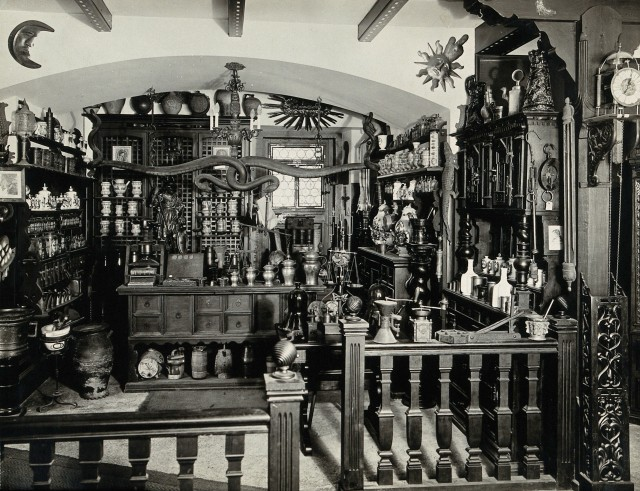 Image of an apothecary shop with various bottles and containers stacked on shevles